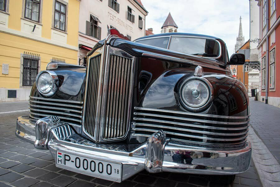 Vintage luxury limousine parked on the street in the old town in Buda in Hungary