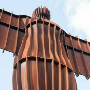 Anthony Gormley's Angel Of The North seen close up looking up at the body and outstretched arms