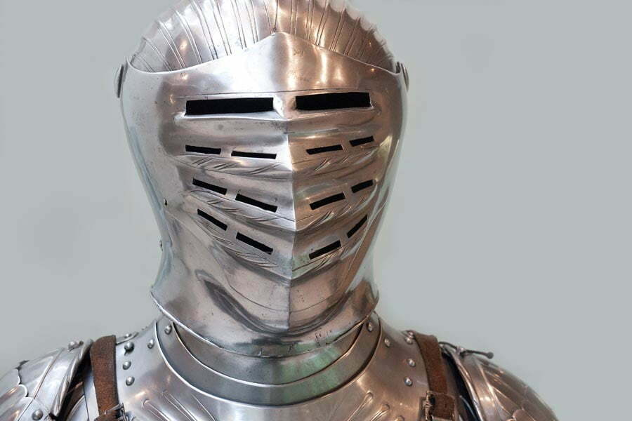 A visor and shiny metal breastplate armour with leather retaining straps