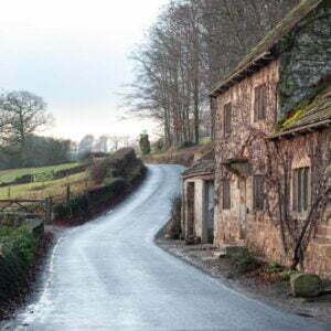 Country road past cottages near Bolton Abbey in Wharfedale, North Yorkshire, England
