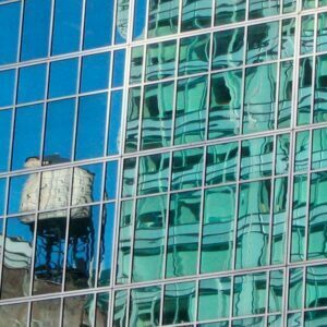 Water tank reflected in the windows of a skyscraper in New York City