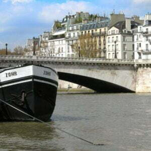 Barge and bridge on the River Seine in Paris