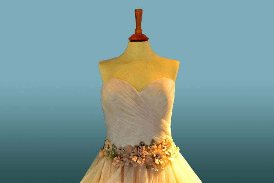Strapless gown with corsage around the waist, with the gown on a headless mannequin tailor's dummy