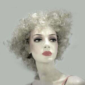 Female mannequin with stylish curly hair wearing a dress with thin pink straps