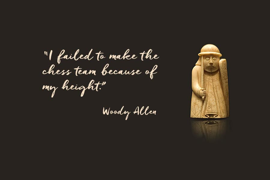"""A Lewis chess piece and a quotation from Woody Allen """"I failed to make the chess team because of my height."""""""